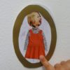Child's collage of a girl in a red dress